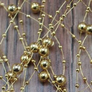 Бусинки на леске золотистые